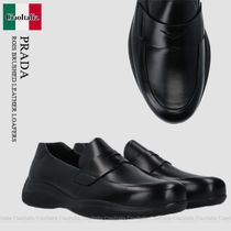 PRADA ROIS BRUSHED LEATHER LOAFERS
