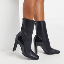 ASOS DESIGN Evident spliced high heeled boot