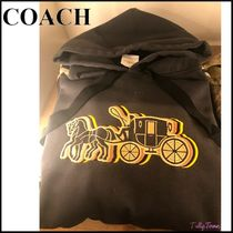 【COACH】OVERSIZED HORSE AND CARRIAGE HOODIE フーディ