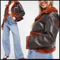 COLLUSION faux leather jacket in brown with orange furdetail