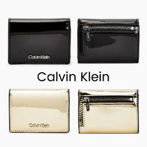 UK発★CALVIN KLEIN 'SMALL PATENT TRIFOLD WALLET'
