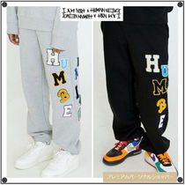 I AM NOT A HUMANBEINGのLOGOED PATCHWORK SWEAT PANTS 全2色