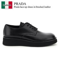 Prada lace-up shoes in brushed leather