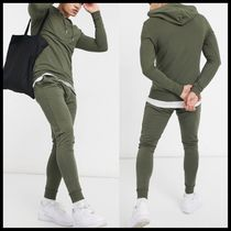 ASOS DESIGN muscle fit tracksuit with super skinny jogger