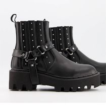 Lamoda chunky boots with harness detail in black