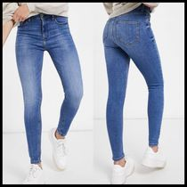 River Island high rise skinny jeans in mid blue
