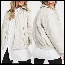 ASOS DESIGN leather look padded bomber jacket in putty