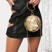 ASOS DESIGN sphere clutch bag in gold cage