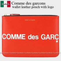 Comme des garcons wallet leather pouch with logo