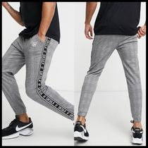 ASOS SikSilk dog tooth cuffed joggers with side tape detail