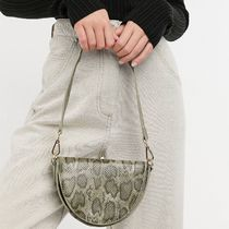 ASOS DESIGN cross body saddle bag in green snake