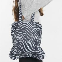 ASOS DESIGN shopper with ruffle in zebra print