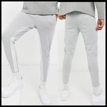 ASOS The Couture Club jersey joggers with taping