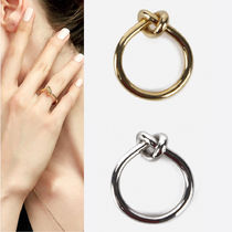 CELINE KNOT RING IN BRASS