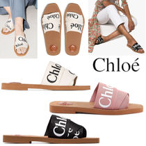 CHLOE WOODY FLAT MULES IN CANVAS