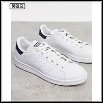 adidas Originals Vegan Stan Smith trainers in white and navy