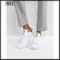 Adidas Originals Stan Smith trainers in white and green