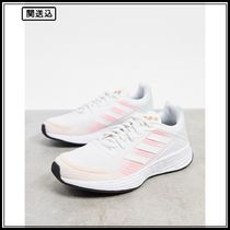 adidas Running Duramo SL trainers in white and pink
