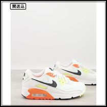 Nike Air Max 90 trainers in off white and orange