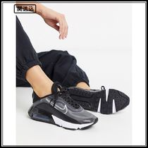 Nike Air Max 2090 trainers in black and silver