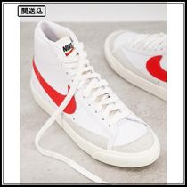 Nike Blazer Mid 77 trainers in white and red