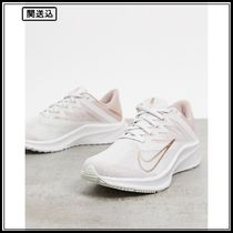 Nike Running Quest 3 trainers in off white