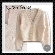 【& Other Stories】Ribbed cardigan with flower buttons