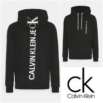 UK発★CALVIN KLEIN JEANS GRAPHIC BACK LOGO フーディ パーカー
