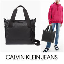 UK発★CALVIN KLEIN JEANS ロゴ付きナイロントートバッグ