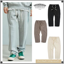 FRIZMWORKSのPIPING SWEAT PANTS 全4色