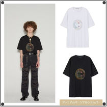 ANDERSSON BELL(アンダースンベル) Tシャツ・カットソー ANDERSSON BELLのUNISEX SMILE EARTH EMBROIDERY T-SHIRT 全2色
