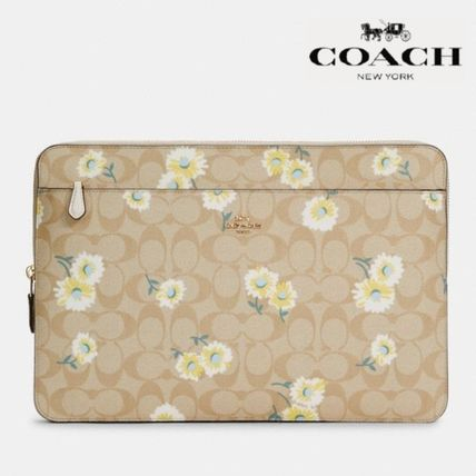 【COACH】Laptop Sleeve In Signature Canvas With Daisy C3365