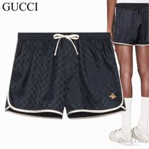 GUCCI  GG nylon swim shorts with bee