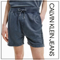UK発CALVIN KLEIN Hand Dyed ロゴ付きハーフパンツ