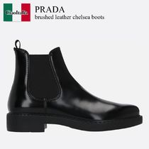 Prada brushed leather chelsea boots