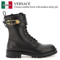 Versace combat boots with medusa safety pin