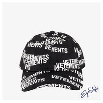 HAT WITH ALL-OVER LOGO